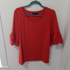 BNWT 3/4 sleeve top with floral cuffs
